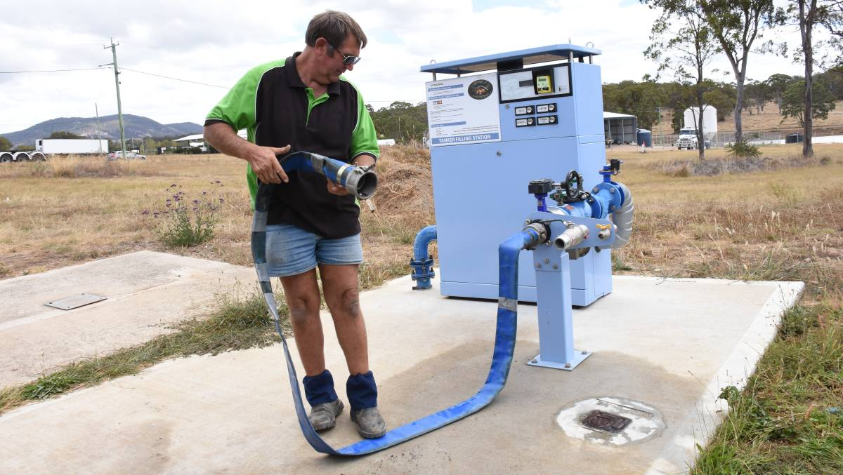 Water carter Col Graham fills up at the Tenterfield water dispensing station. Urbenville will have a similar installation in coming months.